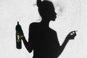 Shadow of girl with cigarette