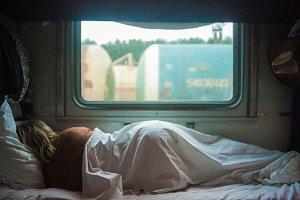 A woman sleeps on the train