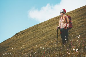 Woman traveler hiking alone