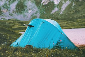 Tent camping at rocky mountains
