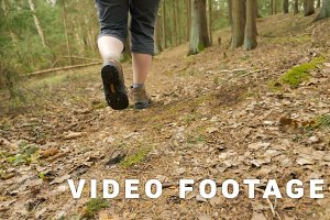 Legs of young girl in the summer forest - flying camera slowmotion 180 fps shot