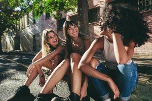 Three beautiful girls sitting