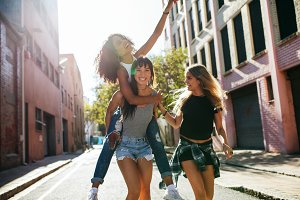 Three young woman having fun