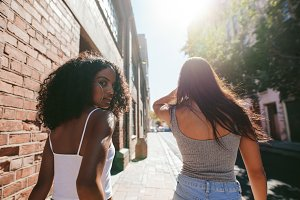 Young women walking together