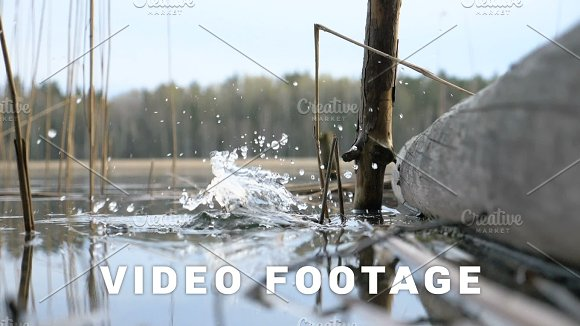 Water Splash Of Cone Drop From The Hand To The River Slowmotion 180 Fps