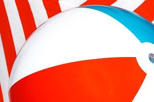 Beach ball on striped background