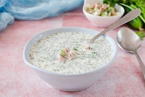 Okroshka. Summer light cold yogurt soup with cucumber, radish, eggs and dill on a table. A traditional dish of Russian and Ukrainian cuisine. Selective focus