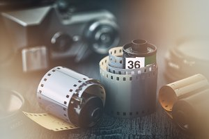 Old photo film rolls and camera