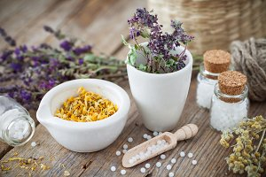 Healing herbs and homeopathic bottle