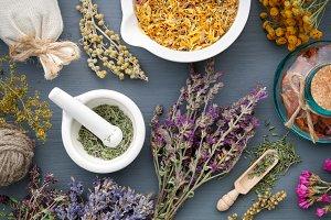 Medicinal herbs, mortar and sachet.