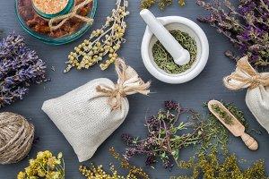 Medicinal herbs, sachet and mortar.