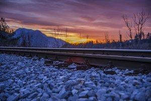 Sunrise in purple over railway track