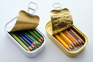 Colored pencils in tins