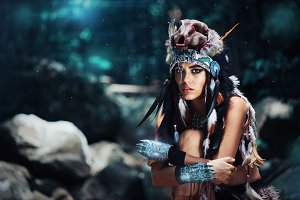 Futuristic indian woman portrait outdoors. blue wild forest on background