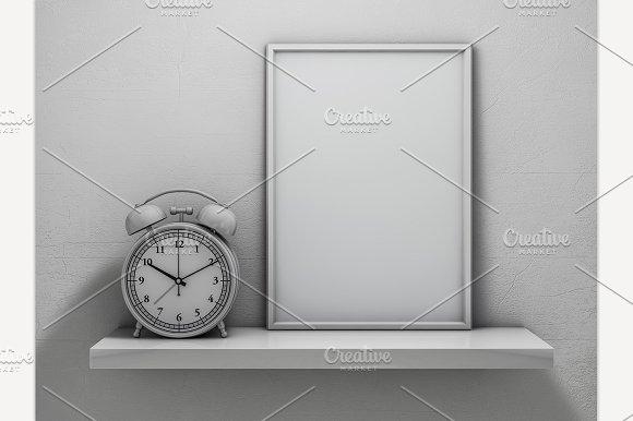 Blank Frame Poster On The Shelf