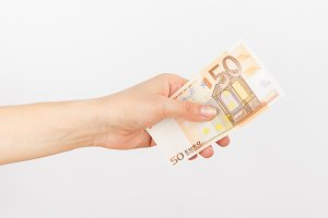 Fifty euro in the woman's hand, light background
