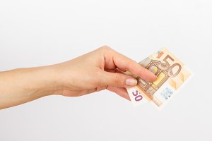Fifty euro in the woman's hand