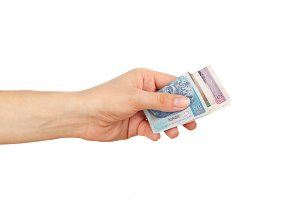 Few zloty in the woman's hand, isolated