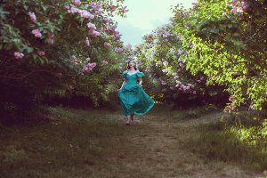 Woman runs through the garden.