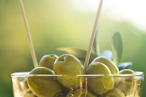 glass with olives
