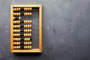 Accounting abacus on gray background