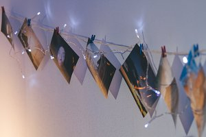 Set of photos hanging on clothesline