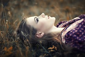 hippie girl lying on the grass