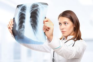 female doctor looking at the x-ray