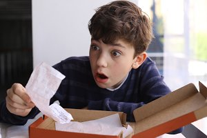 teenager boy shocked expression after see bill for pizza