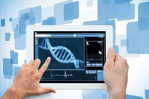 Hand holding a medical digital tablet