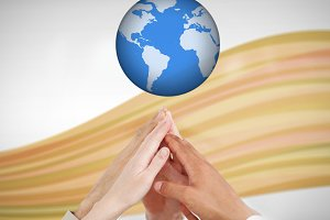 People reaching hands up to a globe against white background with orange wave