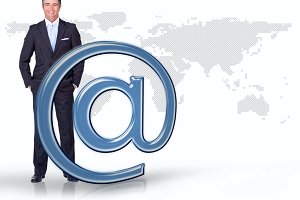 Businessman standing with blue email at symbol