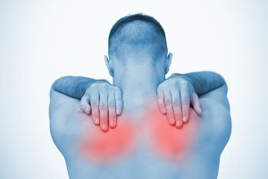 Man touching highlighted sore shoulders