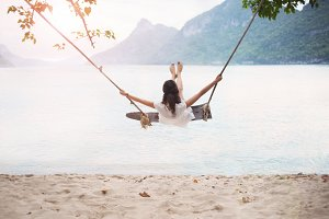 woman on swing on beautiful beach