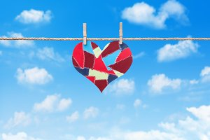 heart hanging on clothesline in sky
