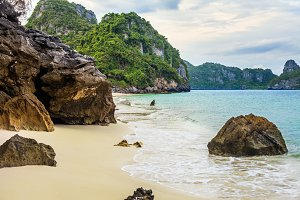 tropical beach with rocks