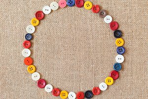 Circle from buttons on fabric