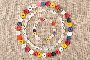 Circles from buttons on fabric