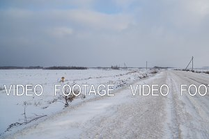 Winter landscape of fields and roads.
