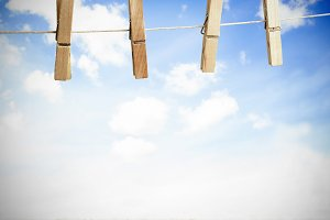 Clothespin on a laundry line outside with bright blue sky