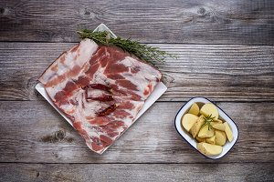 Raw pork ribs with herbs