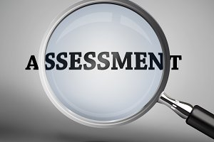 Magnifying glass showing assessment word