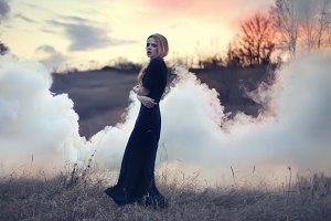 sensual beautiful girl in smoke
