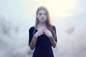 sensual girl in white smoke