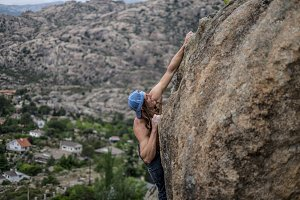 Man climbing the rock in Pedriza, Spain