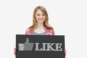 Smiling girl holding panel with thumb up representing social network logo