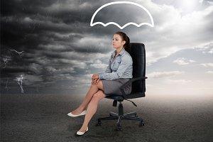 Umbrella graphic above the head of a businesswoman