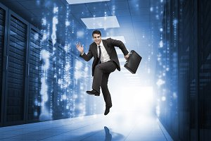 Businessman jumping in a corridor