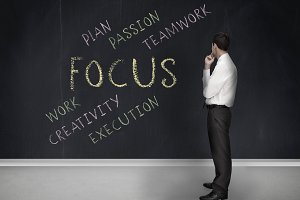 Businessman looking at the word focus
