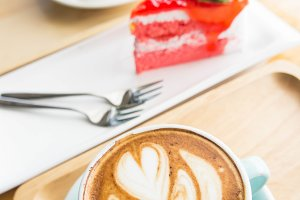 latte coffee cup and cake on table